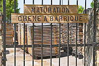 Bel Air stores its own oak staves to be used later for making barrels, the sign says maturation oak for barriques Chateau Belair (Bel Air) 1er premier Grand Cru Classe Saint Emilion Bordeaux Gironde Aquitaine France