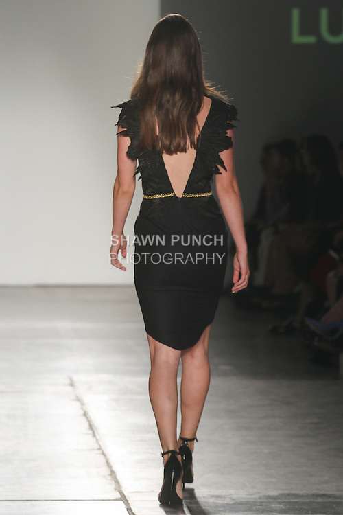 Model walks runway in an outfit from Luom.O collection by Luom Ousby, for Fashion Palette Australian Evening & Bridal Show Spring Summer 2016, duing New York Fashion Week Spring 2016.