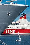 Finland, Helsinki, Cruise ships in Helsinki Harbor with small sail boat between ocean liners, Scandinavia, Baltic Sea, .