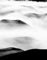 Morning clouds around Pu'u O Maui and other cinder cones at Haleakala National Park, Maui.
