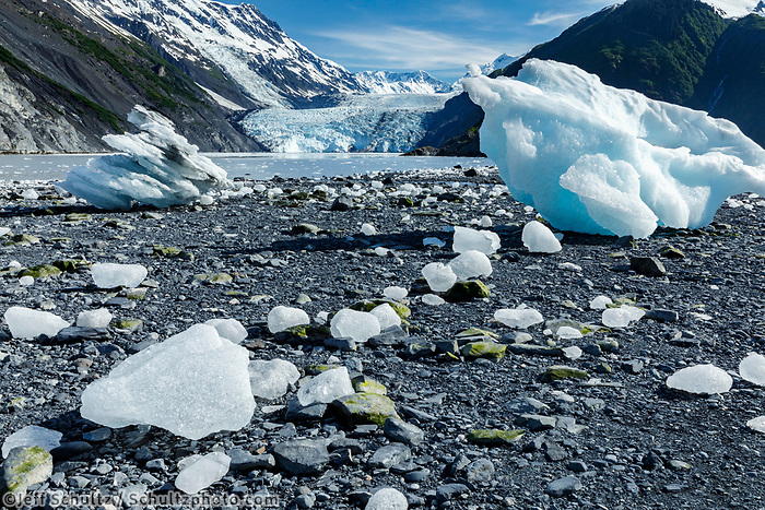 Summer landscape of landlocked Ice bergs on shore in Prince William Sound in Harriman Fjord in front of Barry Glacier with Chugach Mountains<br /> <br /> <br /> Photo by Jeff Schultz/  (C) 2019  ALL RIGHTS RESERVED