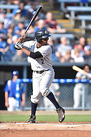 Charleston RiverDogs designated hitter Abiatal Avelino #12 awaits a pitch during a game against the Asheville Tourists at McCormick Field July 26, 2014 in Asheville, North Carolina. The RiverDogs defeated the Tourists 8-7. (Tony Farlow/Four Seam Images)