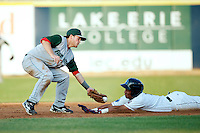 Fort Wayne TinCaps Tyler Stubblefield #14 attempts to tag Luigi Rodriguez #6 sliding in safely during a game against the Lake County Captains at Classic Park on July 2, 2012 in Eastlake, Ohio.  Fort Wayne defeated Lake County 5-4.  (Mike Janes/Four Seam Images)
