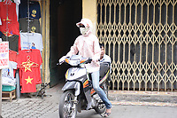 Hanoi<br /> , Vietnam - 2007 File Photo -<br /> <br /> A woman wearing jeans and  a scarf to protect from pollution sit on a scooter in Hanoi.<br /> <br /> <br /> <br /> photo : James Wong-  Images Distribution