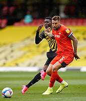 Sonny Bradley of Luton Town (5) (right) gets to grip with Ismaila Sarr (23) of Watford during the Sky Bet Championship match between Watford and Luton Town at Vicarage Road, Watford, England on 26 September 2020. Photo by David Horn.