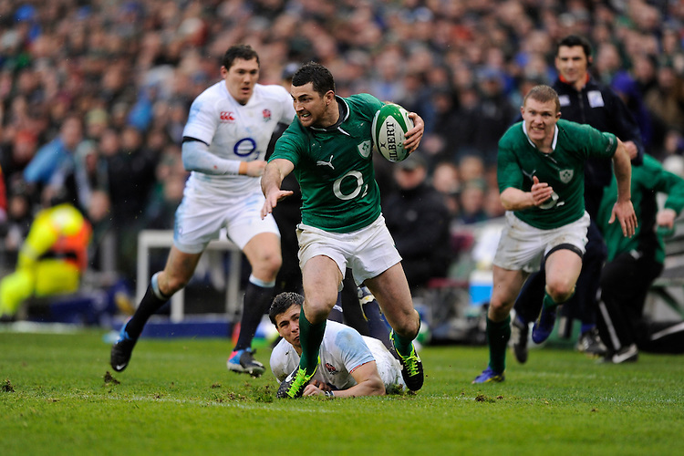 Rob Kearney of Ireland escapes the tackle of Ben Youngs of England during the RBS 6 Nations match between Ireland and England at the Aviva Stadium, Dublin on Sunday 10 February 2013 (Photo by Rob Munro)