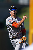 Glendale Desert Dogs shortstop Chan Jong Moon (39) follows through on a throw to first during an Arizona Fall League game against the Mesa Solar Sox on October 14, 2015 at Sloan Park in Mesa, Arizona.  Glendale defeated Mesa 7-6.  (Mike Janes/Four Seam Images)