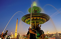France, Paris, Place de la Concorde, fountains illuminated at night