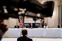 From left to right: Brad Smith, President, Microsoft; United States President Donald J. Trump; Sonia Syngal, CEO, Gap Inc.; and US Secretary of the Treasury Steven T. Mnuchin during a roundtable discussion with industry leaders on reopening the American economy in the State Dining Room of the White House in Washington, DC on May 29, 2020. <br /> Credit: Erin Schaff / Pool via CNP/AdMedia
