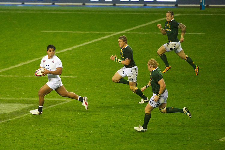 Manu Tuilagi of England looks for support after finding a gap in midfield during the QBE Autumn International match between England and South Africa at Twickenham on Saturday 24 November 2012 (Photo by Rob Munro)
