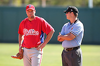 Philadelphia Phillies Cody Overbeck talks with the umpire during an exhibition game vs the Netherlands National Team  at Al Lang Field in St. Petersburg, Florida;  March 13, 2011.  Photo By Mike Janes/Four Seam Images
