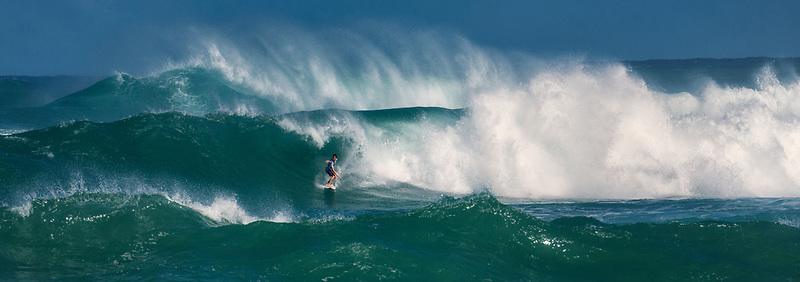 Surfer at Sunset Beach Support, Oahu, Hawaii