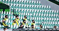 23rd May 2020, Volkswagen Arena, Wolfsburg, Lower Saxony, Germany; Bundesliga football,VfL Wolfsburg versus Borussia Dortmund; The Dortmund  substitutes sit spaced apart in the stands