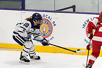 WORCESTER, MA - FEBRUARY 08: Carly Beniek #10 of Holy Cross brings the puck forward during a game between Boston University and College of the Holy Cross at Hart Center Rink on February 08, 2020 in Worcester, Massachusetts.