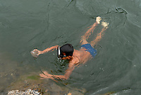 LAOS, Nam Ou river, children dive and wash gold for chinese enterprise, Nam Ou , is a branch of Mekong River