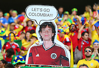 Colombia fans hold a poster with Mick Jagger wearing a Colombia shirt saying 'Let's go Colombia!!!'