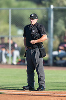 Home plate umpire Brandon Dinslage during an Arizona League game between the AZL Cubs 1 and the AZL Indians 1 at Sloan Park on August 27, 2018 in Mesa, Arizona. The AZL Cubs 1 defeated the AZL Indians 1 by a score of 3-2. (Zachary Lucy/Four Seam Images)