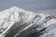 Mount Lincoln from along the Franconia Ridge Trail (a link of the Appalachian Trail), on Little Haystack Mountain, in the New Hampshire White Mountains on a cloudy winter day. Mount Lincoln is named after Abraham Lincoln, 16th President of the United States.
