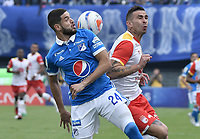 BOGOTA - COLOMBIA -16 -07-2017: Matias D Los Santos (Izq) jugador de Millonarios disputa el balón con Denis Stracqualursi (Der) jugador de Independiente Santa Fe durante partido por la fecha 2 de la Liga Aguila II 2017 jugado en el estadio Nemesio Camacho El Campin de la ciudad de Bogota. / Matias D Los Santos (L) player of Millonarios fights for the ball with Denis Stracqualursi (R) player of Independiente Santa Fe during match for the date 2 of the Liga Aguila II 2017 played at the Nemesio Camacho El Campin Stadium in Bogota city. Photo: VizzorImage / Gabriel Aponte / Staff.