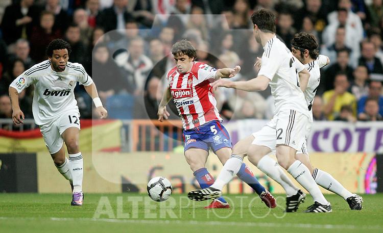 Real Madrid's Marcelo against Sporting de Gijon's Alberto Rivera during La Liga match. March 20, 2010. (ALTERPHOTOS/Alvaro Hernandez)