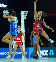 Kate Burley takes a pass under pressure from Kimiora Poi during the ANZ Premiership netball final between Northern Mystics and Mainland Tactix at Spark Arena in Auckland, New Zealand on Sunday, 8 August 2021. Photo: Dave Lintott / lintottphoto.co.nz