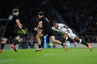 Semesa Rokoduguni of England puts in a tackle on Israel Dagg of New Zealand during the QBE International match between England and New Zealand at Twickenham Stadium on Saturday 8th November 2014 (Photo by Rob Munro)