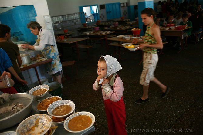 Children clean up after lunch in the cafeteria of the Gymnasia-Internat Number 2 boarding school and orphanage in Chisinau, Moldova on 28 May 2009. The school has over 500 children living on the campus. Around 80% are social orphans -- children whose parents are still alive, but were turned over to institutional care by the parents.