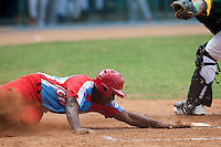 15 February 2009: Alfredo Despaigne of the Orientales scores during a training game of Cuba Baseball Team for the World Baseball Classic 2009. The national team is pitted against itself, divided in two teams called the Occidentales and the Orientales. The Orientales win 12-8, at the Latinoamericano stadium, in la Habana, Cuba.