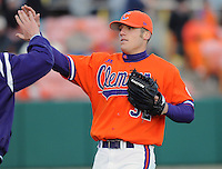 RHP Trey Delk (32) is congratulated after coming out of a game between the Charlotte 49ers and Clemson Tigers Feb. 20, 2009, at Doug Kingsmore Stadium in Clemson, S.C. It was Clemson's season opener, and Delk got the win as the Tigers won 8-3. (Photo by: Tom Priddy/Four Seam Images)
