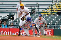 Bradenton Marauders first baseman Jose Osuna #36 blocks a throw as Matt Reynolds #23 slides back into first with coach Benny Distefano #30 in the background during a game against the St. Lucie Mets on April 12, 2013 at McKechnie Field in Bradenton, Florida.  St. Lucie defeated Bradenton 6-5 in 12 innings.  (Mike Janes/Four Seam Images)