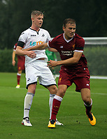 Pictured: Adam King of Swansea (L). Friday 11 August 2017<br /> Re: Premier League 2, Division 1, Swansea City U23 v Liverpool U23 at the Landore Training Ground, Swansea, UK
