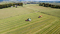 13/09/18<br /> <br /> ***Caption correction: forage harvester not combine harvester as in previous***<br /> <br /> Tractors work alongside a forage harvester to make hay in the autumn sunshine on Throwley Moor near Calton in the Staffordshire Peak District. Photographed from a drone with all relevant permissions etc.<br />  <br /> All Rights Reserved, F Stop Press Ltd. (0)1335 344240 +44 (0)7765 242650  www.fstoppress.com rod@fstoppress.com