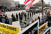WASHINGTON DC - JANUARY 20: Anti-Bush anti-war protesters on the parade route greet Bush with boos and signs. January 20, 2005 in Washington DC. (photo by Anthony Suau)