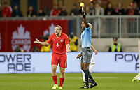 TORONTO, ON - OCTOBER 15: Samuel Piette of Canada is shown yellow by referee Daneion Parchment during a game between Canada and USMNT at BMO Field on October 15, 2019 in Toronto, Canada.