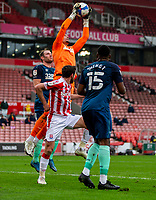 20th March 2021; Bet365 Stadium, Stoke, Staffordshire, England; English Football League Championship Football, Stoke City versus Derby County; Goalkeeper Kelle Roos of Derby County goes up high to make a save