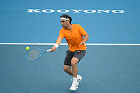 MELBOURNE, AUSTRALIA - JANUARY 12: MARCOS BAGHDATIS (CYP) in action against TOMAS BERDYCH (CZE) on day 4 of the 2013 AAMI Classic event at the Kooyong Lawn Tennis Club in Melbourne, Australia. (Photo Sydney Low).Berdych def Baghdatis 6-3, 6-2