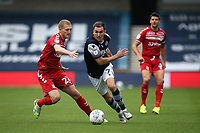 Jed Wallace of Millwall and George Saville of Middlesbrough during Millwall vs Middlesbrough, Sky Bet EFL Championship Football at The Den on 8th July 2020