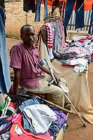 RWANDA, Butare, booth with second hand clothes from US with Dollar price tag of value village / RUANDA, Altkleider Geschaeft auf dem Markt, Kleidung aus den USA vom discounter value village mit Dollar Preisschild