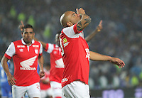 BOGOTA -COLOMBIA. 02-03-2014. Omar Perez de Independiente Santa Fe  celebra su gol contra  Millonarios   partido por la novena fecha de La liga Postobon 1 disputado en el estadio Nemesio Camacho El Campin. / Omar Perez  of Independiente Santa Fe  celebrates his goal  against Millonarios  during the match for the nine round of The Postobon one league match at Nemesio Camacho El Campin  Stadium . Photo: VizzorImage/ Felipe Caicedo / Staff