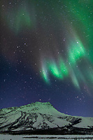 Aurora borealis over the Brooks Range mountains, Arctic, Alaska.