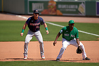 Boston Red Sox first baseman Josh Ockimey (76) holds Brent Rooker (50) on during a Major League Spring Training game against the Minnesota Twins on March 17, 2021 at JetBlue Park in Fort Myers, Florida.  (Mike Janes/Four Seam Images)