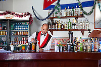 Cuba, Trinidad.  Bartender at Work.  The red, yellow, and green drink is called a Trinidad Colonial.