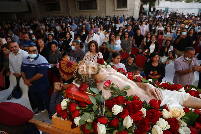 """Palestinian Christians attend the """"Good Friday"""" celebrations in the West Bank city of Jenin on April 30, 2021.  Christian denominations around the world celebrate """"Good Friday"""" as the remembrance of the day on which the Prophet Jesus, was crucified. Photo by Oday Daibes"""