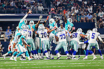 Dallas Cowboys guard Zack Martin (70), Dallas Cowboys center Joe Looney (73), Dallas Cowboys tackle Doug Free (68), Dallas Cowboys kicker Dan Bailey (5), Miami Dolphins linebacker James-Michael Johnson (56) in action during the pre-season game between the Miami Dolphins and the Dallas Cowboys at the AT & T stadium in Arlington, Texas.