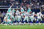 Dallas Cowboys guard Zack Martin (70), Dallas Cowboys center Joe Looney (73), Dallas Cowboys tackle Doug Free (68), Dallas Cowboys kicker Dan Bailey (5), Miami Dolphins linebacker James-Michael Johnson (56) in action during the pre-season game between the Miami Dolphins and the Dallas Cowboys at the AT & T stadium in Arlington, Texas.