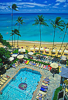 Sheraton Moana Surfrider (Hawaii's oldest hotel). Vacationers enjoy poolside luxery and Waikiki Beach.