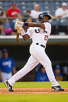 Jackie Bradley Jr. #23 of Team USA follows through on his swing against Team Korea at Knights Stadium July 16, 2010, in Fort Mill, South Carolina.  Photo by Brian Westerholt / Four Seam Images