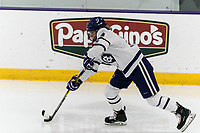 WORCESTER, MA - FEBRUARY 08: Rachel Moore #18 of Holy Cross passes the puck during a game between Boston University and College of the Holy Cross at Hart Center Rink on February 08, 2020 in Worcester, Massachusetts.