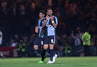 Paul Hayes (right) of Wycombe Wanderers and Joe Jacobson of Wycombe Wanderers applaud the supporters post match during the Capital One Cup match between Wycombe Wanderers and Fulham at Adams Park, High Wycombe, England on 11 August 2015. Photo by Andy Rowland.