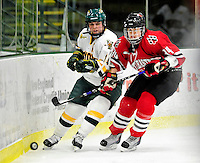 30 October 2009: University of Vermont Catamount defenseman Peggy Wakeham, a Junior from Bay Roberts, Newfoundland, defends against Northeastern University Huskies' forward Kristi Kehoe, a Junior from Bakersfield, CA, at Gutterson Fieldhouse in Burlington, Vermont. The Catamounts were shut out by the visiting Huskies 3-0. Mandatory Credit: Ed Wolfstein Photo